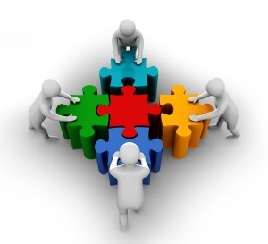 team_members_pushing_puzzle_to_build_shape_stock_photo_Slide01
